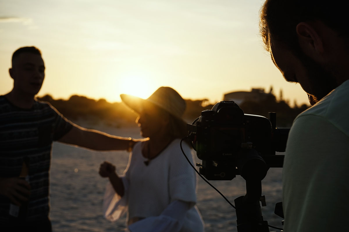 Filmming actors at sunset