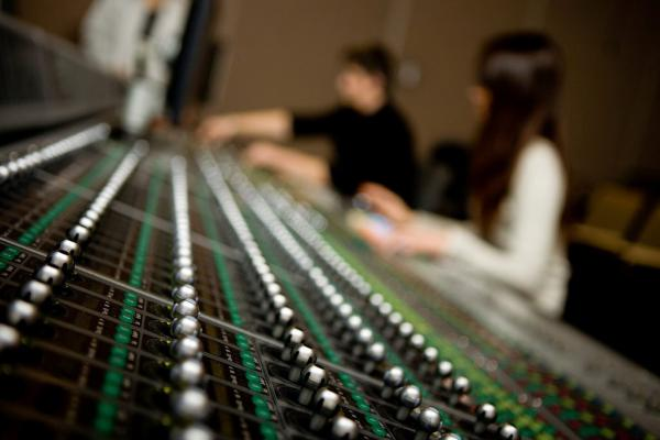 People working on a sound mixing desk