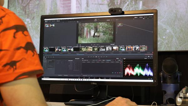 A close up of someone using DaVinci Resolve 16